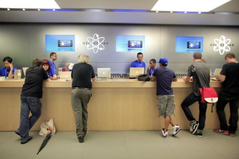 People are served at the Genius Bar at the Apple Store 5th Avenue in New York
