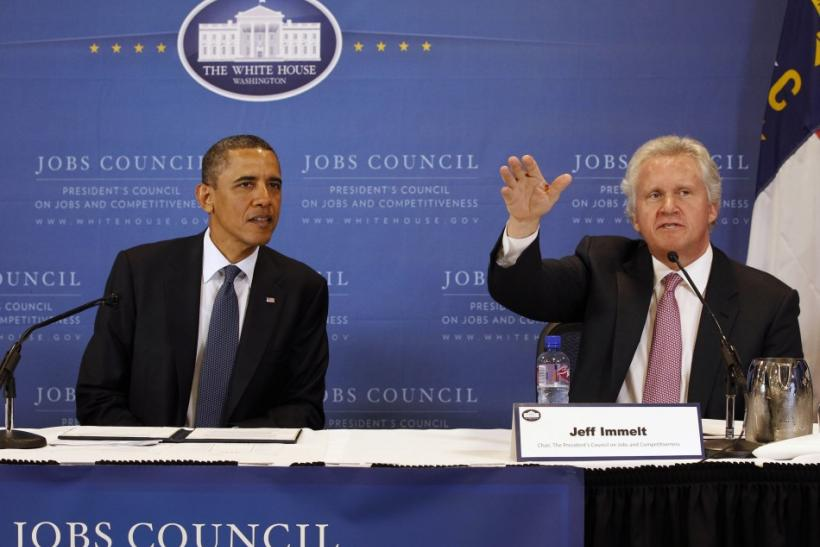 U.S. President Barack Obama sits next to Chairman of the council and CEO of General Electric Jeffrey Immelt