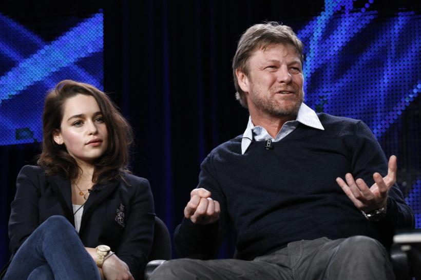 "Cast member Sean Bean answers a question, as co-star Emilia Clarke watches, at the HBO panel for the television series ""Game of Thrones"" during the Television Critics Association winter press tour in Pasadena, California January 7, 2011."
