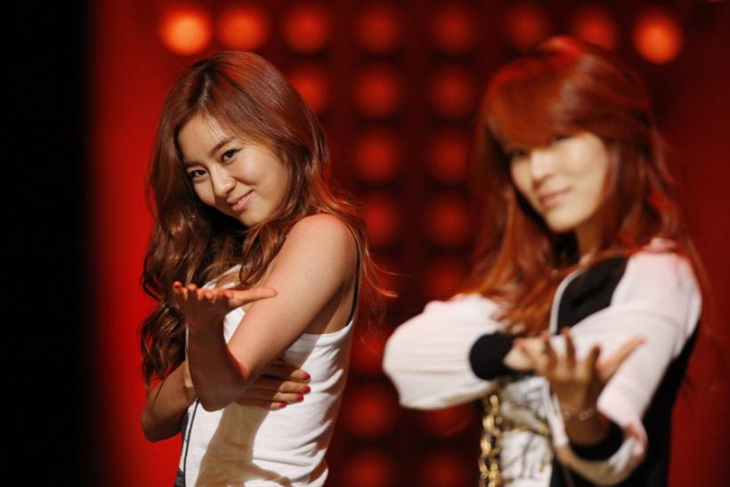 Kahi and U-Ie, members of South Korean girl group After School, perform at a show of a local TV station in Seoul