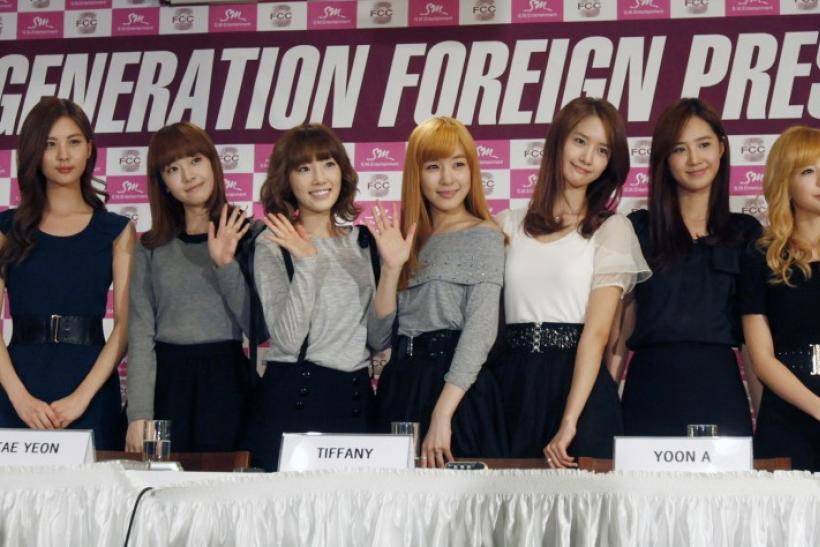 Members of South Korean pop group Girls' Generation pose during a news conference for foreign media in Seoul