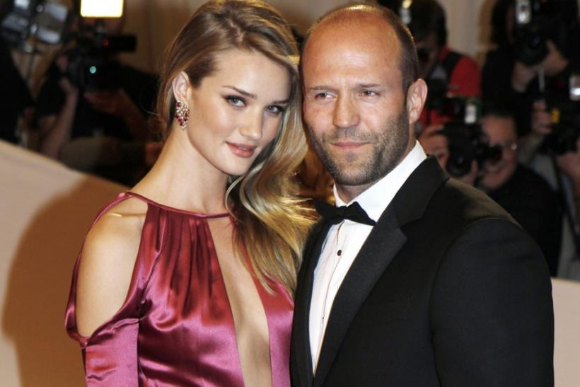 Model Rosie Huntington-Whiteley and actor Jason Statham pose on arrival at the Metropolitan Museum of Art Costume Institute Benefit celebrating the opening of Alexander McQueen: Savage Beauty, in New York