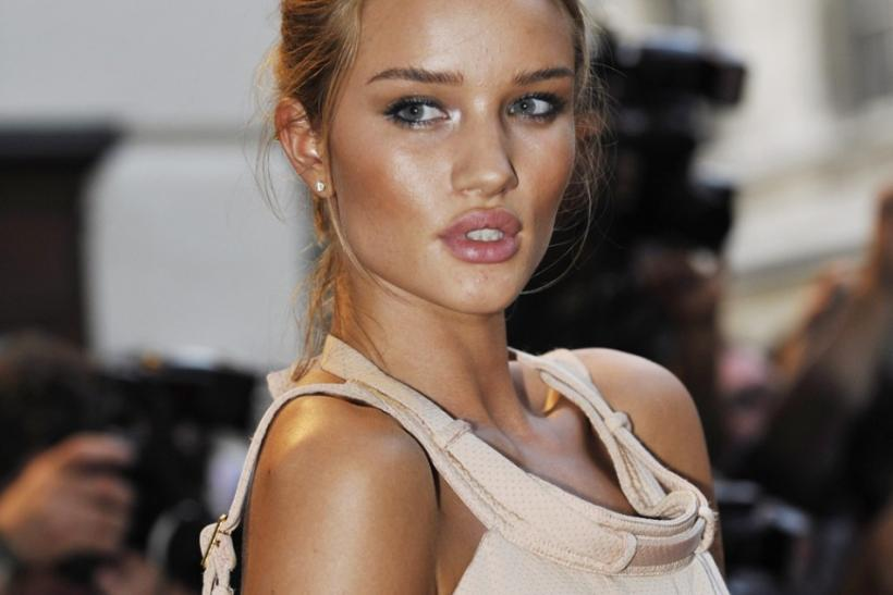 British model Rosie Huntington-Whiteley arrives for the GQ Men of the Year Awards in central London