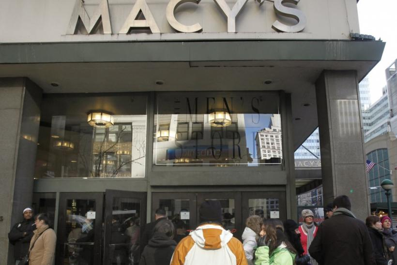 People wait for a Macy's department store to open in New York January 7, 2010. U.S. retailers including Macy's posted higher December sales and raised profit forecasts as they carefully managed promotions to lure shoppers during the holidays.