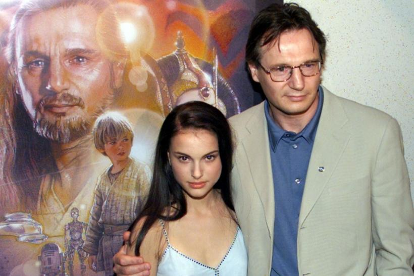 Actress Natalie Portman and actor Liam Neeson pose for photographers as they arrive at the New York ..