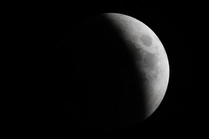 The Moon is seen in Dubai during a lunar eclipse, marking the beginning of the third week of the Islamic month of Rajab, June 15, 2011.