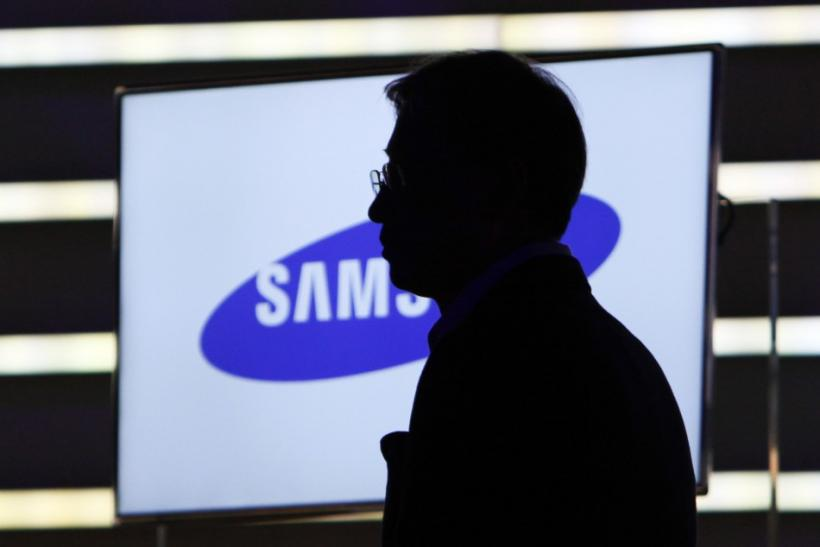 Yoon Boo-keun, head of Samsung's TV division, watches a video at the Samsung keynote address on the opening day of the Consumer Electronics Show (CES) in Las Vegas