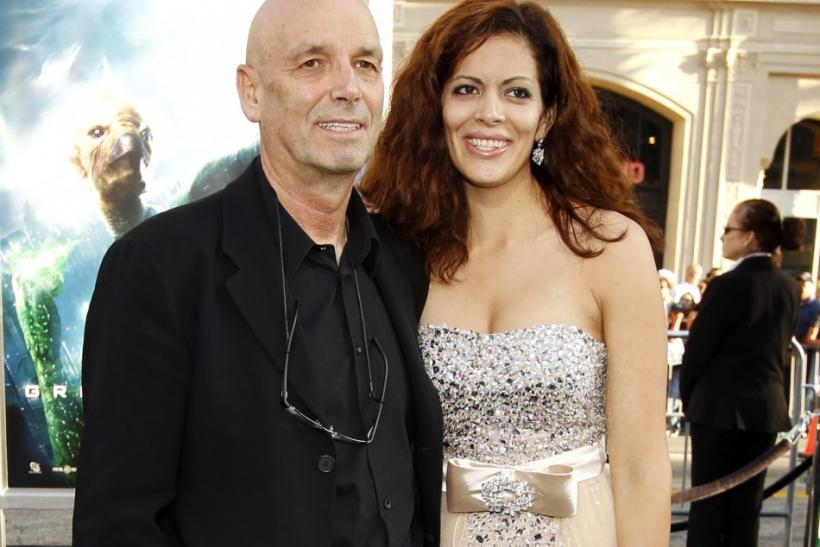 """Director Martin Campbell and his wife Sol E. Romero pose at the premiere of his movie """"Green Lantern"""" at the Grauman's Chinese theatre in Hollywood, California June 15, 2011. The movie opens in the U.S. on June 17."""