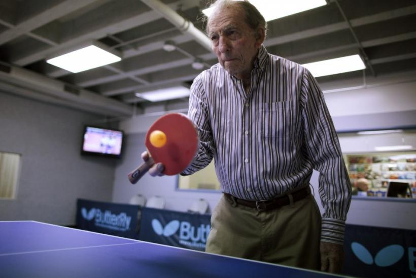 A man plays ping pong at a program for people with Alzheimer's and dementia in Los Angeles