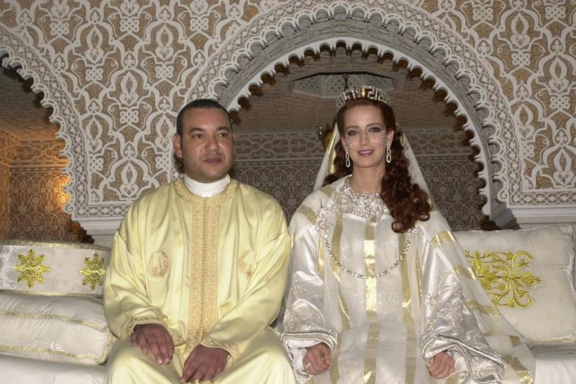Morocco's King Mohammed VI poses with his bride unveiled Salma Bennani for an official photograph.