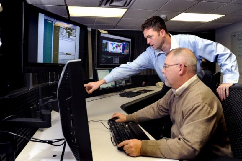 U.S. Department of Homeland Security (DHS) employees work on the Industrial Control Systems Cyber Emergency Response Team (ICS-CERT) operational watch floor at the Idaho National Laboratory in Idaho Falls, Idaho