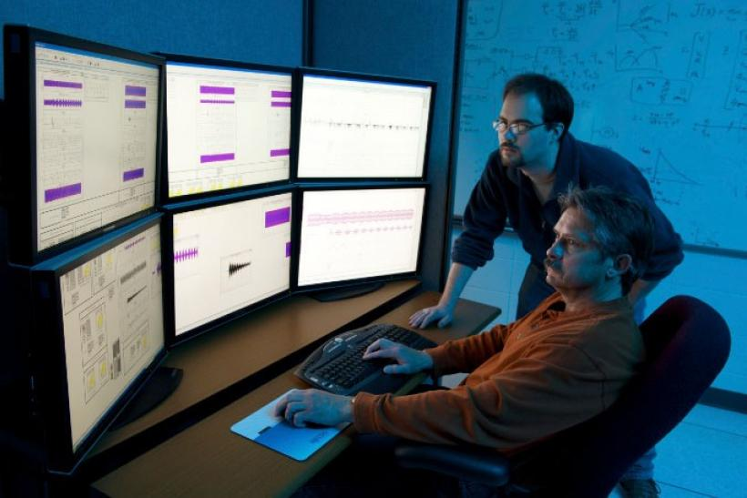 Department of Homeland Security (DHS) researchers use advanced modeling and simulation equipment as they work on the DHS Control Systems Security Program (CSSP) at the Idaho National Laboratory in Idaho Falls, Idaho