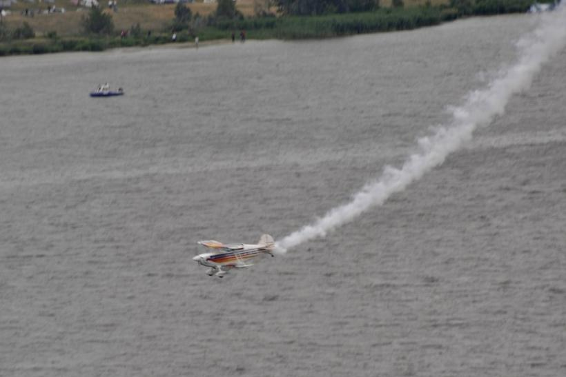 A small acrobatic plane flown by Marek Szufla crashes in the Vistula River during an air show in the city of Plock