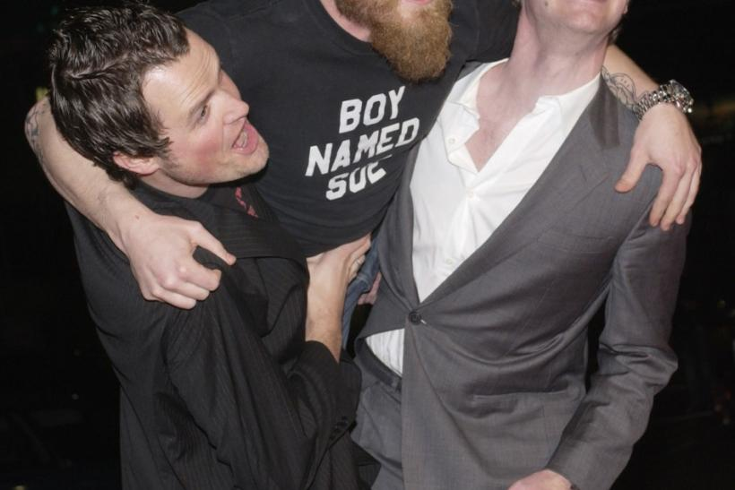 "Steven Green (L), the director of ""Gumball 3000 - The Movie,"" cast member Ryan Dunn (C) and Maximillion Cooper, who launched ""Gumball 3000"" in 1999, ham it up for photographers during the premiere of the film at Grauman's Chinese"