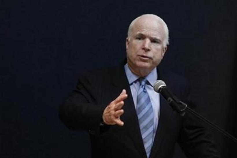 Senator John McCain talks to reporters during a news conference at the American Centre in Yangon June 3, 2011.