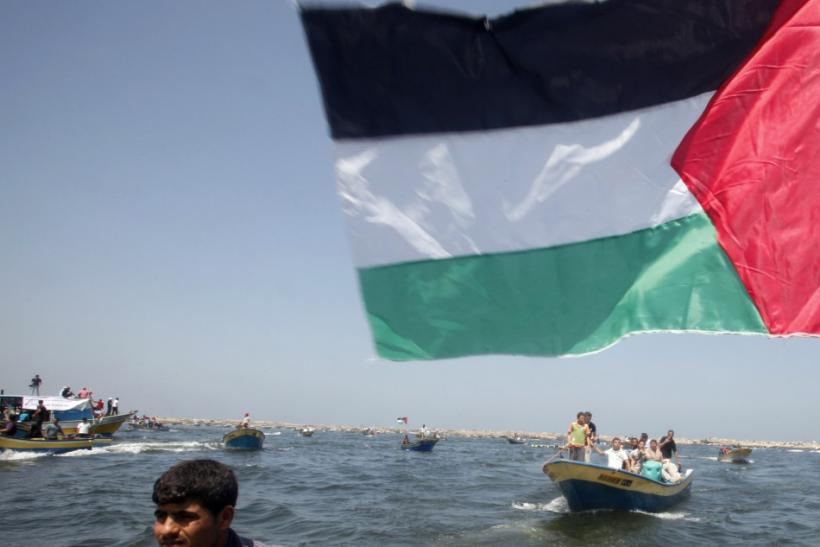 Palestinians ride boats in the Mediterranean Sea off the coast of Gaza City