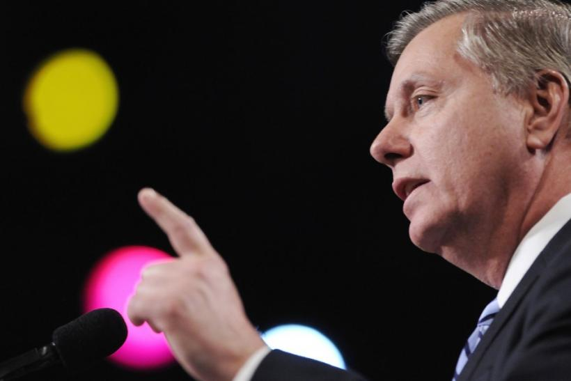 US Senator Graham points as he addresses the gala banquet of the AIPAC annual policy conference in Washington