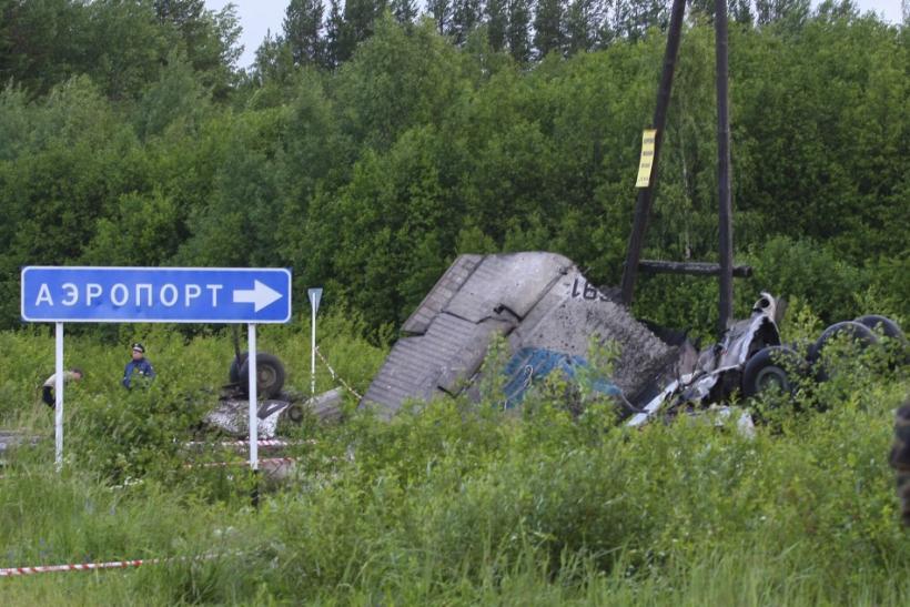 Personnel from the Russian emergency services work at the site of a plane crash outside Petrozavodsk