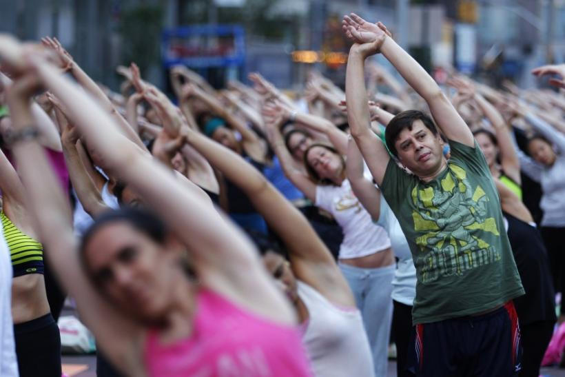 "People practice yoga on the morning of the summer solstice in New York's Times Square June 21, 2010. The eighth annual ""Solstice in Times Square"" event on Monday brought out thousands of participants to celebrate the year's longest day"