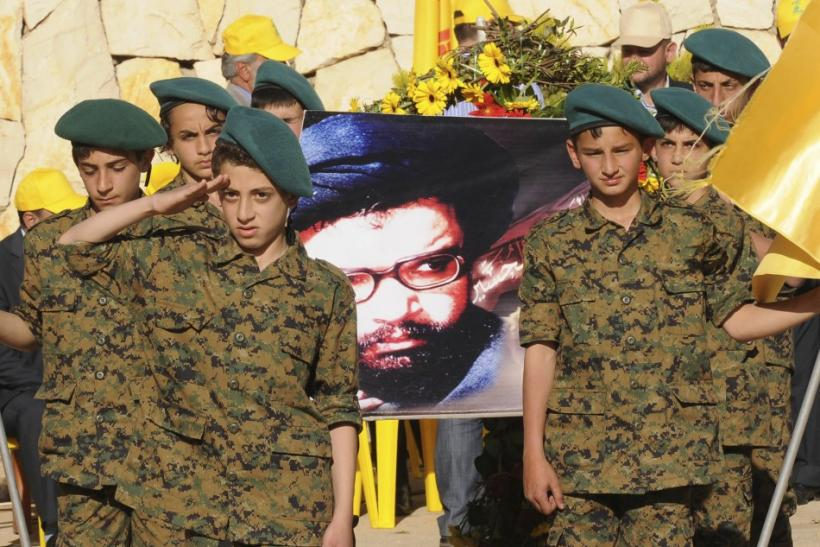 Supporters of Lebanon's Hezbollah listen to a televised address during a rally marking Resistance and Liberation Day in Nabi Sheet