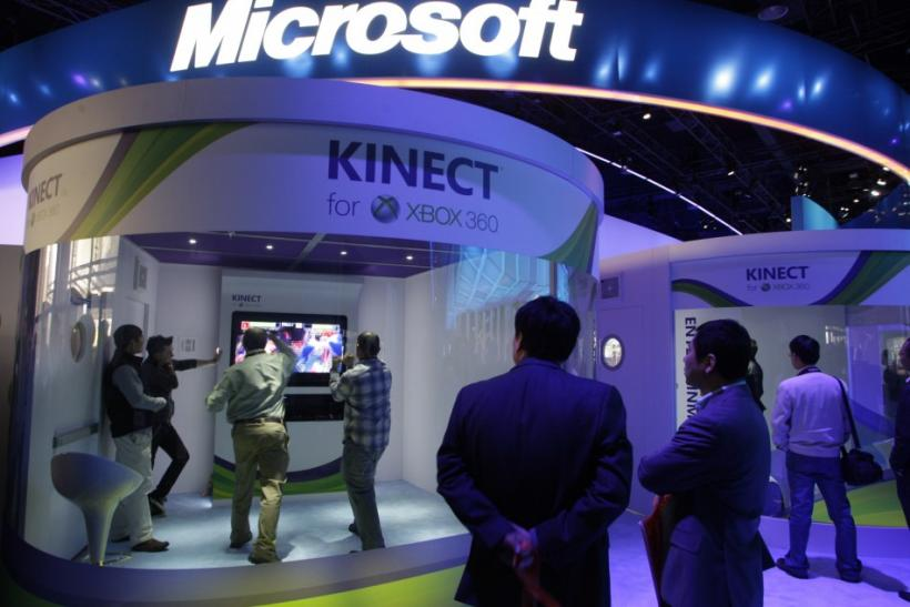 People play a Kinect boxing game on an XBox 360 gaming console