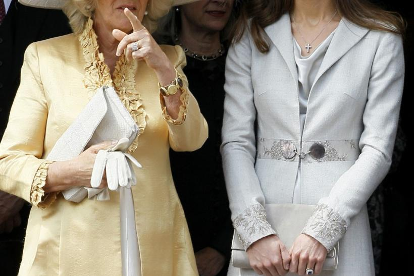 Catherine, Duchess of Cambridge chats with Camilla Duchess of Cornwall during the procession pass of the Order of The Garter Service in Windsor