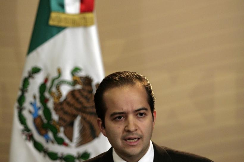Mexican National Security spokesman Alejandro Poire addresses the media in a news conference over arrest of Jose de Jesus Mendez