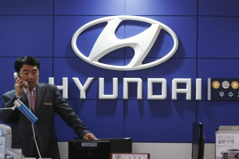 A salesman talks on a phone at a Hyundai Motor dealership in Seoul April 28, 2011.