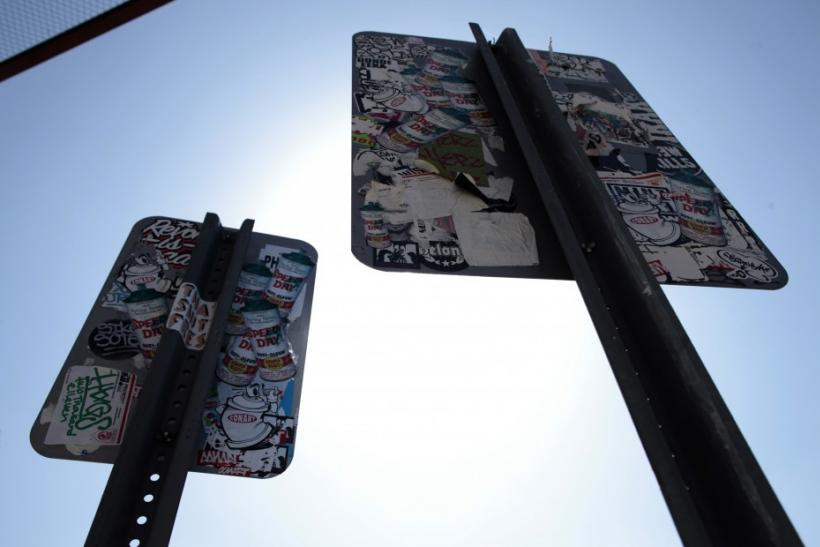 Defaced road signs are seen outside the 'Art In The Streets' exhibit