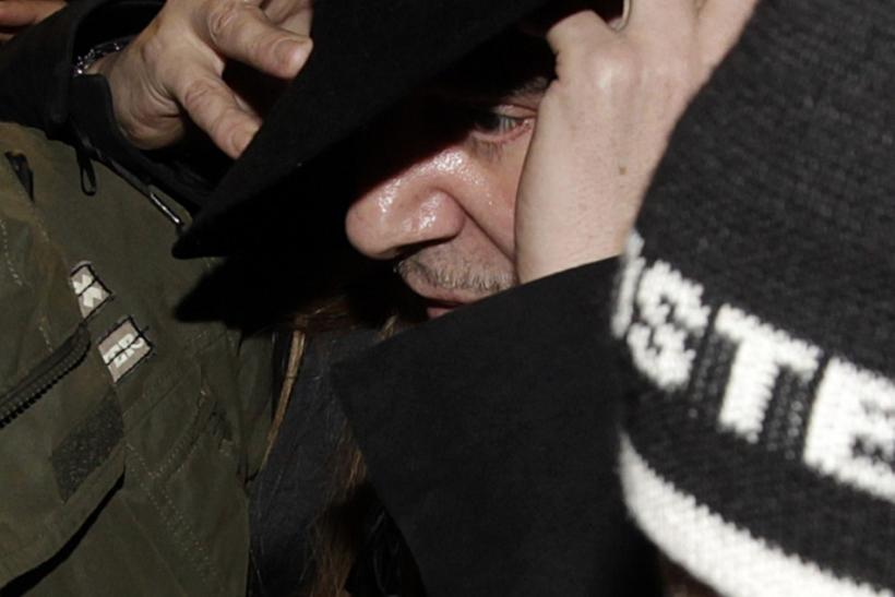 Fashion designer John Galliano leaves after a hearing in a police station in Paris