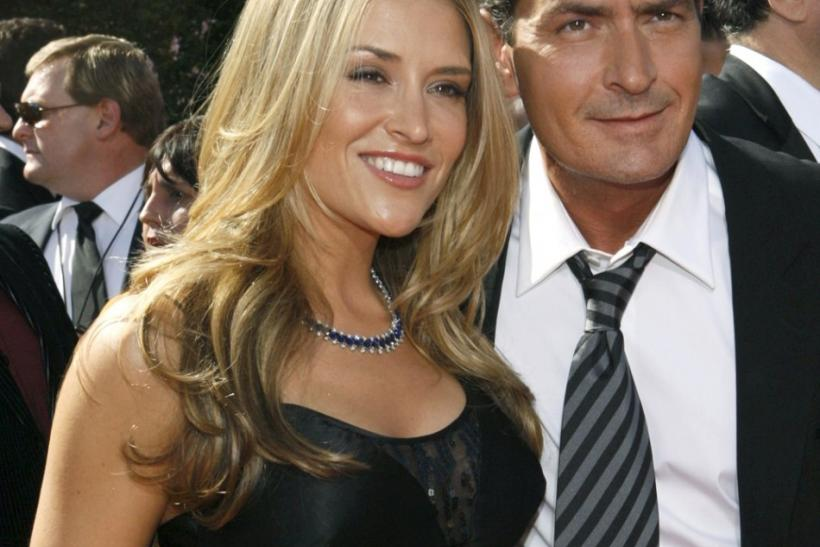 Actor and nominee Charlie Sheen arrives with Brooke Mueller at the 59th Primetime Emmy Awards in Los Angeles