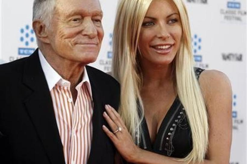 Hugh Hefner and Crystal Harris arrive at the opening night gala of the 2011 TCM Classic Film Festival featuring a screening of a restoration of 'An American In Paris' in Hollywood, California April 28, 2011.