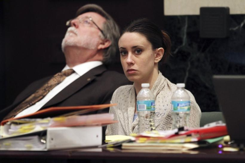 Casey Anthony looks on beside her attorney Cheney Mason