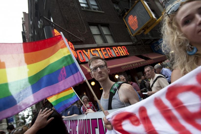 Protesters take part in a demonstration supporting same-sex marriages outside Sheraton Hotel where U.S. President Obama was attending a function in New York.