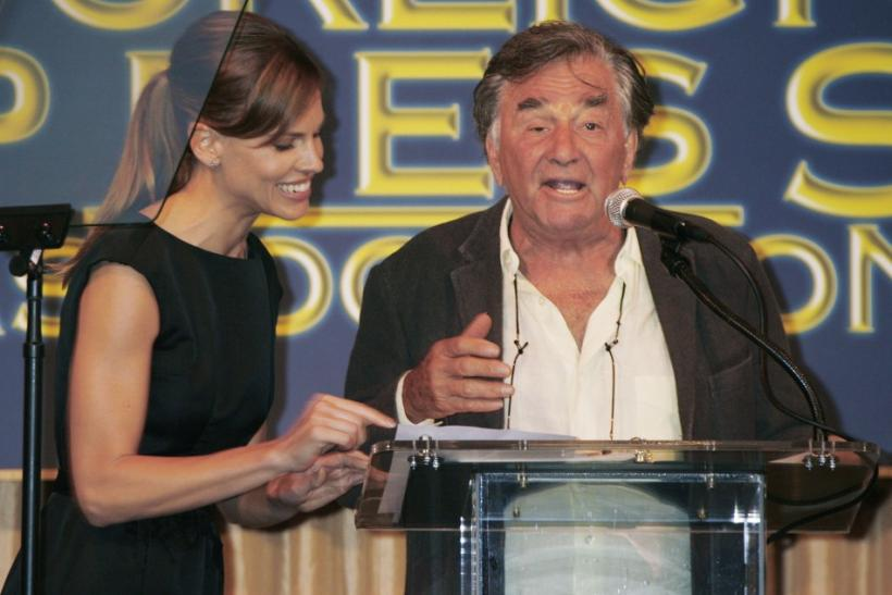 Actor Peter Falk (R) gets some help with his script from actress Hilary Swank as he presents a contribution from the Hollywood Foreign Press Association during their annual Installation luncheon in Beverly Hills, California August 9, 2007.
