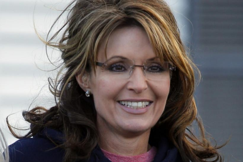 Former Alaska Governor Sarah Palin wears a New Hampshire sweatshirt during a stop at a clam bake at a private residence in Seabrook