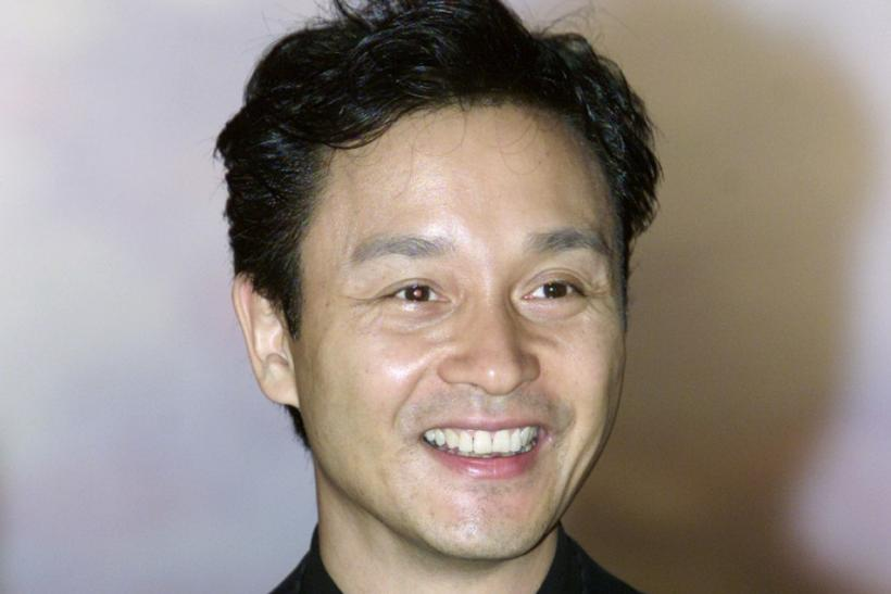 Hong Kong singer-actor Leslie Cheung poses before a fashion show in Hong Kong March 21, 2002. Cheung..