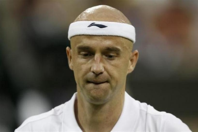 Ivan Ljubicic of Croatia reacts during his match against Andy Murray