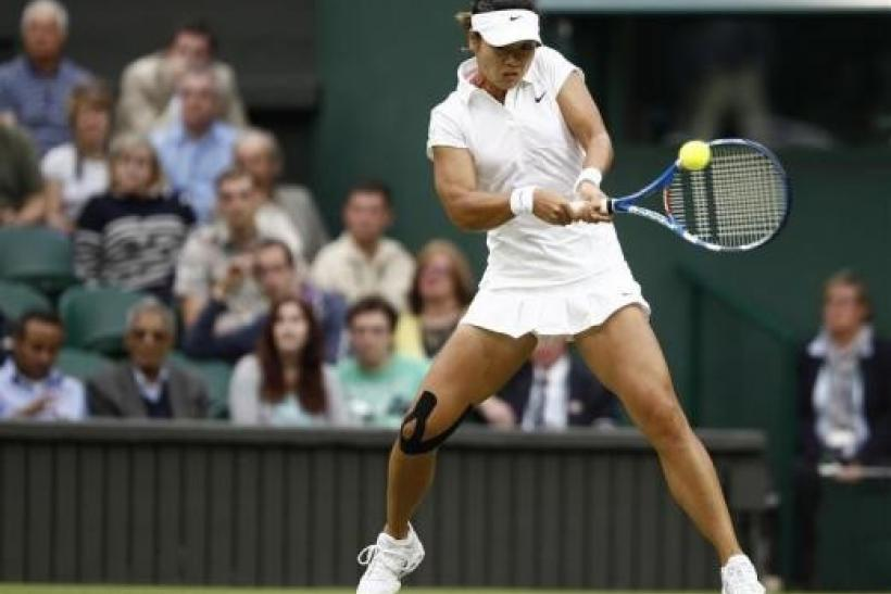 Li Na of China hits a return to Sabine Lisicki