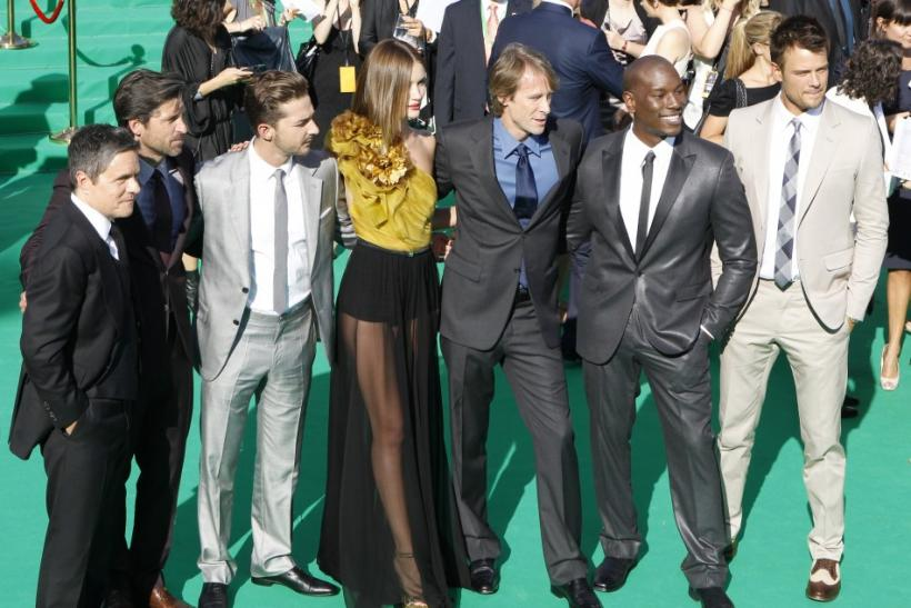 roducer Tom DeSanto, cast members Patrick Dempsey, Shia LaBeouf, Rosie Huntington-Whiteley, director Michael Bay, Tyrese Gibson, and Josh Duhamel pose before the premiere of Transformers: Dark of the Moon at the opening of the Moscow International Film Fe