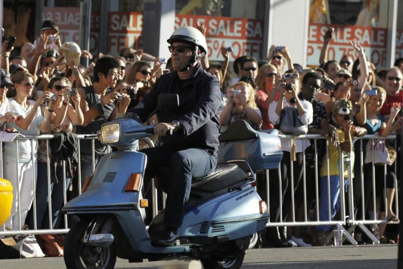"Hanks rides a scooter as he arrives at the world premiere of ""Larry Crowne"" at the Chinese theatre in Hollywood"