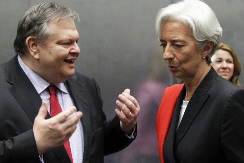 Greece's Finance Minister Venizelos talks to France's Finance Minister Lagarde