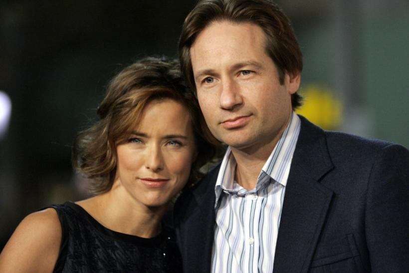 "Cast member Tea Leoni and her husband David Duchovny attend the Los Angeles premiere of Columbia pictures' ""Fun with Dick and Jane"" at the Mann Village theatre in Los Angeles December 14, 2005."