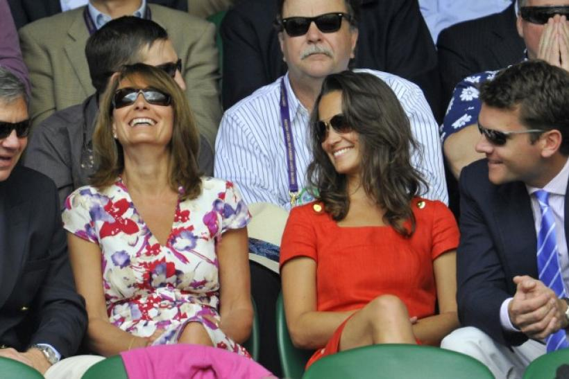 The parents of Catherine, Duchess of Cambridge, Michael (L) and Carole Middleton (2nd L), and her sister Pippa (3rd L), sit on Centre Court for the quarter-final match between Jo-Wilfried Tsonga of France and Roger Federer of Switzerland at the Wimbledon