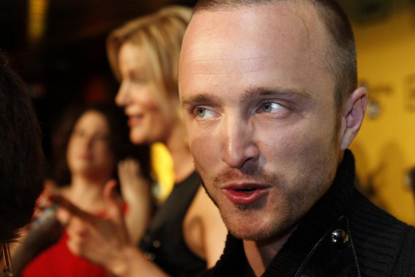 Actor Aaron Paul, star of AMC's drama television series 'Breaking Bad', is interviewed as he arrives for the premiere screening for the show's fourth season in Hollywood