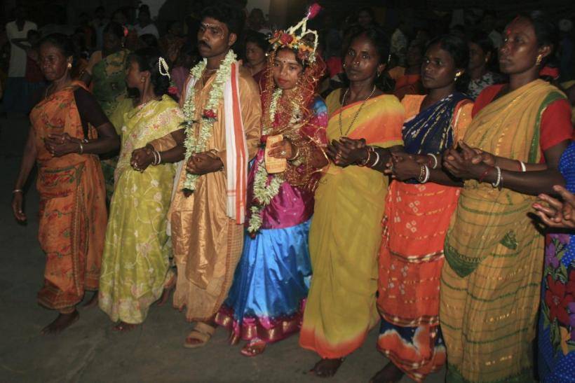 Newly married Santhal tribe couple celebrate during a marriage ceremony at Palla Road