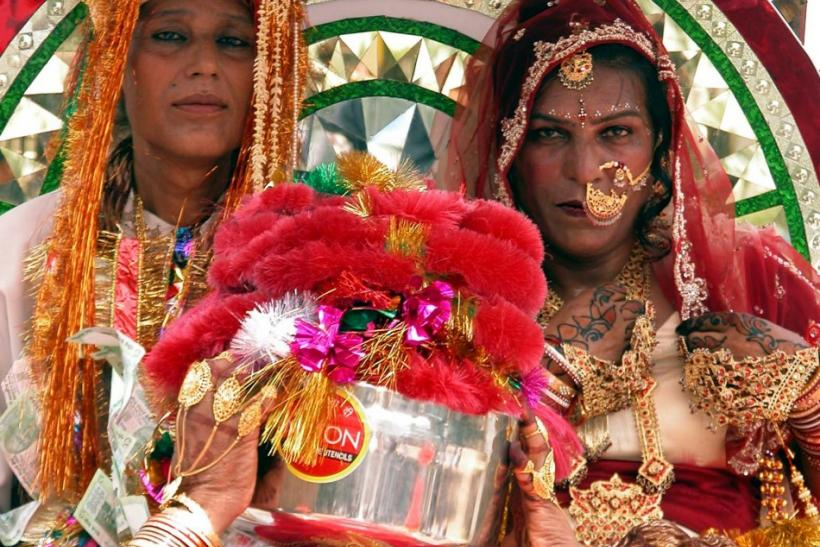 Indian eunuchs Shinder (back R) and Rekha (back L) sit beside each other during their marriage in Ra..