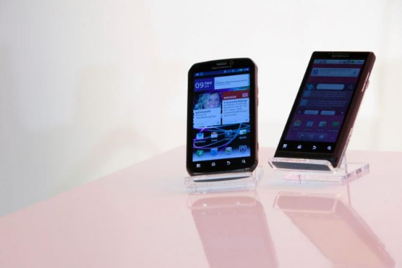 The Motorola PHOTON 4G Summer (L) and the Motorola TRIUMPH Virgin Mobile Summer mobile phones are seen during their launch in New York June 9, 2011