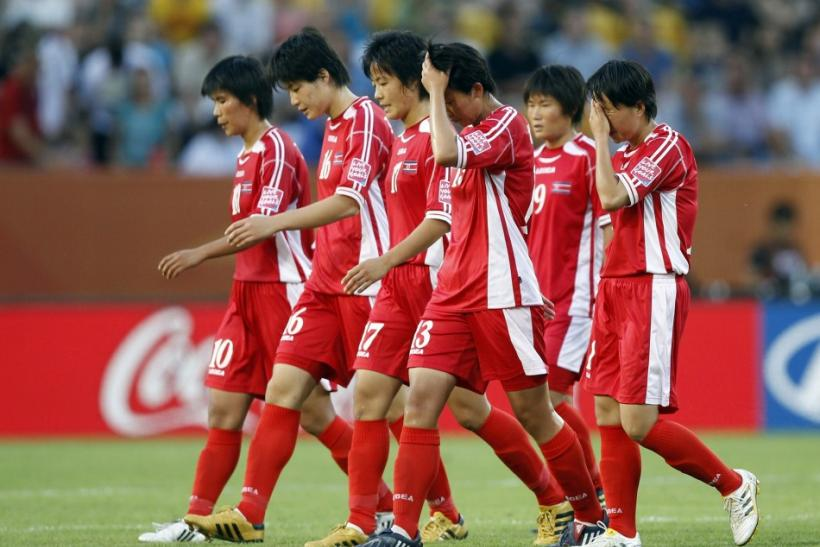Players of North Korea leave the pitch after being defeated by the U.S. during their Women's World Cup Group C soccer match in Dresden June 28, 2011.