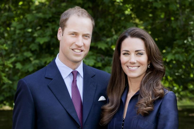 Britain's Prince William and Catherine, Duchess of Cambridge pose for the official tour portrait for their trip to Canada and California, in the gardens of Clarence House in London June 3, 2011.
